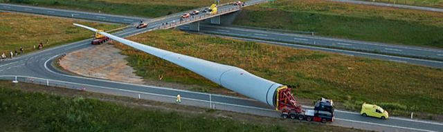 A wind turbine being transported on a lorry
